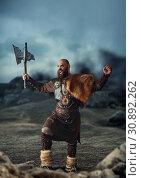 Купить «Viking with axe raised his hands up, barbarian», фото № 30892262, снято 27 марта 2019 г. (c) Tryapitsyn Sergiy / Фотобанк Лори
