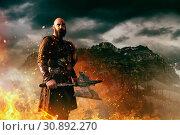 Купить «Angry viking with axe, battle in rocky mountains», фото № 30892270, снято 27 марта 2019 г. (c) Tryapitsyn Sergiy / Фотобанк Лори