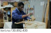 Купить «Professional furniture restorer renewing vintage chest of drawers in workshop», видеоролик № 30892430, снято 22 февраля 2019 г. (c) Яков Филимонов / Фотобанк Лори