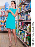 Купить «Nice female want to buying softener in bottle», фото № 30892702, снято 6 июня 2017 г. (c) Яков Филимонов / Фотобанк Лори