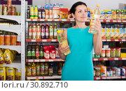 Купить «Woman choosing different oil in bottle», фото № 30892710, снято 6 июня 2017 г. (c) Яков Филимонов / Фотобанк Лори