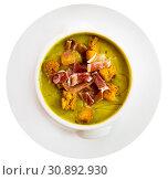 Купить «Top view of creamy zucchini soup with croutons and jamon», фото № 30892930, снято 18 июля 2019 г. (c) Яков Филимонов / Фотобанк Лори