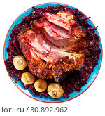 Купить «Baked pork knuckle with red cabbage and baked onion served at plate», фото № 30892962, снято 22 июля 2019 г. (c) Яков Филимонов / Фотобанк Лори