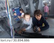 Купить «boys and girls in quest room bunker», фото № 30894886, снято 21 октября 2017 г. (c) Яков Филимонов / Фотобанк Лори