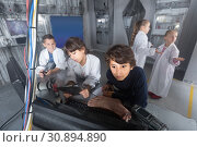 Купить «Children playing in bunker quest room», фото № 30894890, снято 21 октября 2017 г. (c) Яков Филимонов / Фотобанк Лори