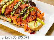 Купить «Photography of plate with toast with lettuce, avocado and cheese», фото № 30895078, снято 24 июня 2018 г. (c) Яков Филимонов / Фотобанк Лори