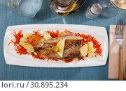 Купить «Fried scomber with vegetables», фото № 30895234, снято 25 января 2020 г. (c) Яков Филимонов / Фотобанк Лори