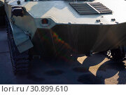 Купить «Parts of the hull of the armored infantry vehicle. In front and back of vehicle stays many different armored military vehicles. Military equipment outdoor open air museum.», фото № 30899610, снято 10 ноября 2018 г. (c) easy Fotostock / Фотобанк Лори