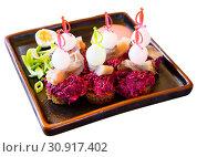 Купить «Canapes of pickled herring with beets», фото № 30917402, снято 26 июня 2019 г. (c) Яков Филимонов / Фотобанк Лори