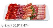 Купить «Sliced jamon, bacon, sausages with olives and greens», фото № 30917474, снято 20 июня 2019 г. (c) Яков Филимонов / Фотобанк Лори