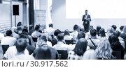 Купить «Male business speaker giving a talk at business conference event.», фото № 30917562, снято 15 июня 2018 г. (c) Matej Kastelic / Фотобанк Лори