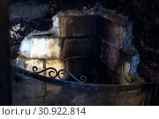 Купить «Soot, stains and burnt bricks gives this traditional fireplace a creepy, gothic look.», фото № 30922814, снято 6 марта 2018 г. (c) easy Fotostock / Фотобанк Лори
