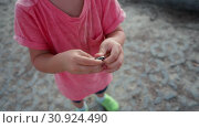 Iron round coin in hands of child. Стоковое видео, видеограф Ekaterina Demidova / Фотобанк Лори