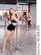 Купить «Sexy young women practicing pole dancing in fitness studio», фото № 30924970, снято 5 апреля 2018 г. (c) Яков Филимонов / Фотобанк Лори