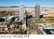 Купить «Cityscape of Barcelona with skyscrapers on embankment», фото № 30925074, снято 24 декабря 2017 г. (c) Яков Филимонов / Фотобанк Лори