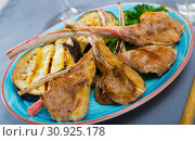 Купить «Image of tasty grilled with eggplants lamb ribs, served with greens», фото № 30925178, снято 20 июля 2019 г. (c) Яков Филимонов / Фотобанк Лори