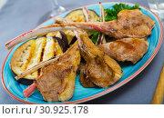 Купить «Image of tasty grilled with eggplants lamb ribs, served with greens», фото № 30925178, снято 26 июня 2019 г. (c) Яков Филимонов / Фотобанк Лори