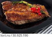 Купить «Grilled beef steak with rosemary», фото № 30925190, снято 29 июня 2018 г. (c) Яков Филимонов / Фотобанк Лори