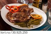 Купить «Entrecote with asparagus and orange», фото № 30925250, снято 20 июля 2019 г. (c) Яков Филимонов / Фотобанк Лори
