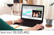 Купить «woman with video editor program on laptop at home», видеоролик № 30925402, снято 23 августа 2019 г. (c) Syda Productions / Фотобанк Лори