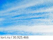 Купить «Sunset colorful sky background - blue dramatic colorful clouds lit by evening sunshine», фото № 30925466, снято 31 мая 2015 г. (c) Зезелина Марина / Фотобанк Лори