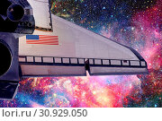 Купить «Space shuttle taking off on a mission. Elements of this image furnished by NASA.», фото № 30929050, снято 12 июля 2020 г. (c) easy Fotostock / Фотобанк Лори