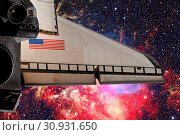 Купить «Space shuttle taking off on a mission. Elements of this image furnished by NASA.», фото № 30931650, снято 12 июля 2020 г. (c) easy Fotostock / Фотобанк Лори