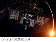 Купить «International Space Station over the planet Earth. Elements of this image furnished by NASA.», фото № 30932054, снято 27 мая 2020 г. (c) easy Fotostock / Фотобанк Лори