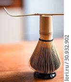 Купить «Bamboo corolla on stand and wooden spoon. Tools for whisking Chinese tea matcha», фото № 30932902, снято 9 марта 2019 г. (c) katalinks / Фотобанк Лори