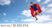 Купить «man in red superhero cape flying over sky», фото № 30933014, снято 3 февраля 2019 г. (c) Syda Productions / Фотобанк Лори