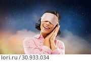 Купить «happy young woman in pajama and eye sleeping mask», фото № 30933034, снято 6 марта 2019 г. (c) Syda Productions / Фотобанк Лори