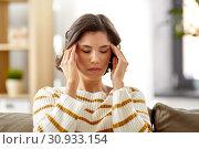 Купить «unhappy woman suffering from head ache at home», фото № 30933154, снято 6 марта 2019 г. (c) Syda Productions / Фотобанк Лори