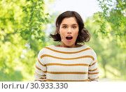 Купить «surprised young woman over natural background», фото № 30933330, снято 6 марта 2019 г. (c) Syda Productions / Фотобанк Лори