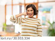 Купить «happy smiling woman showing phone call gesture», фото № 30933334, снято 6 марта 2019 г. (c) Syda Productions / Фотобанк Лори
