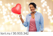 Купить «african american woman with heart-shaped balloon», фото № 30933342, снято 2 марта 2019 г. (c) Syda Productions / Фотобанк Лори