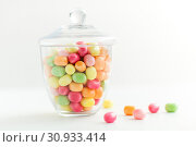 Купить «glass jar with candy drops over white background», фото № 30933414, снято 6 июля 2018 г. (c) Syda Productions / Фотобанк Лори