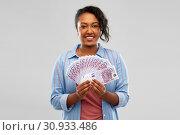 Купить «happy african american woman holding euro money», фото № 30933486, снято 2 марта 2019 г. (c) Syda Productions / Фотобанк Лори