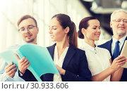 Купить «business team with folders meeting at office», фото № 30933606, снято 3 июля 2016 г. (c) Syda Productions / Фотобанк Лори