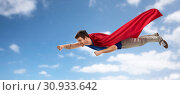 Купить «man in red superhero cape flying over sky», фото № 30933642, снято 3 февраля 2019 г. (c) Syda Productions / Фотобанк Лори
