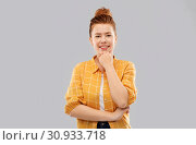 Купить «smiling red haired teenage girl in checkered shirt», фото № 30933718, снято 28 февраля 2019 г. (c) Syda Productions / Фотобанк Лори