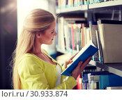 Купить «high school student girl reading book at library», фото № 30933874, снято 19 июня 2016 г. (c) Syda Productions / Фотобанк Лори