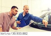 Купить «auto mechanic with clipboard and man at car shop», фото № 30933882, снято 1 июля 2016 г. (c) Syda Productions / Фотобанк Лори