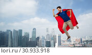 Купить «man in red superhero cape flying in air over city», фото № 30933918, снято 3 февраля 2019 г. (c) Syda Productions / Фотобанк Лори