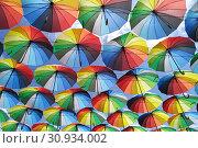 Купить «Colorful umbrellas background. Lots of umbrellas coloring the sky in the city of Odessa, Ukraine. Street decoration», фото № 30934002, снято 13 июня 2019 г. (c) Некрасов Андрей / Фотобанк Лори