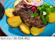 Купить «Beef steak with baked potatoes and sauce at plate with greens», фото № 30934462, снято 26 июня 2019 г. (c) Яков Филимонов / Фотобанк Лори