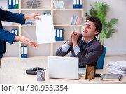 Купить «Young male employee being fired from his work», фото № 30935354, снято 18 февраля 2019 г. (c) Elnur / Фотобанк Лори