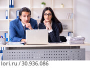Купить «Two employees working in the office», фото № 30936086, снято 25 января 2019 г. (c) Elnur / Фотобанк Лори
