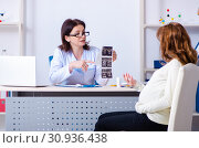 Купить «Young pregnant woman visiting experienced doctor gynecologist», фото № 30936438, снято 11 марта 2019 г. (c) Elnur / Фотобанк Лори