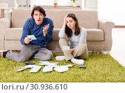 Купить «Young couple in budget planning concept», фото № 30936610, снято 22 января 2019 г. (c) Elnur / Фотобанк Лори