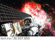 Купить «Astronaut in outer space. Spacewalk. Elements of this image furnished by NASA.», фото № 30937850, снято 12 июля 2020 г. (c) easy Fotostock / Фотобанк Лори